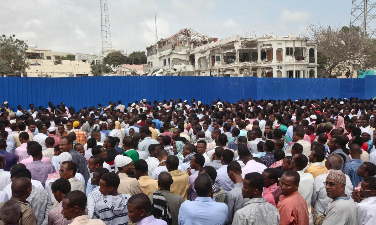 Thousands of Somalis gather to pray at the site of the country's deadliest attack and to mourn the hundreds of victims, at the site of the attack in Mogadishu, Somalia Friday, Oct. 20, 2017.(AP Photo/Farah Abdi Warsameh)