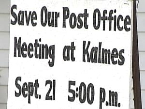 A sign sits in a St. Donatus yard, alerting people of the evening's meeting