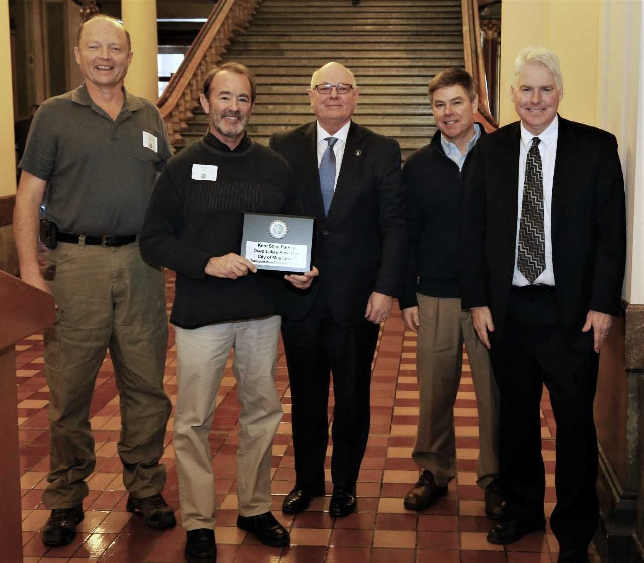 PHOTO CAPTION: Jim Edgmond (far left), city engineer, and Randy Hill, project manager, represented the City of Muscatine at the 1000 Friends of Iowa 2017 Best Development Awards presentation in Des Moines Tuesday (Jan. 16) - Photo: Maharry Photography