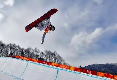 (AP Photo/Kin Cheung). Chloe Kim, of the United States, runs the course during the women's halfpipe qualifying at Phoenix Snow Park at the 2018 Winter Olympics in Pyeongchang, South Korea, Monday, Feb. 12, 2018.