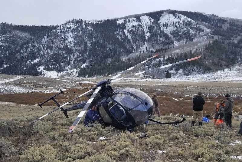 In this photo taken Monday, Feb. 12, 2018, and provided by the Wasatch County Sheriff's Office is a research helicopter that was brought down by a leaping elk in the mountains of eastern Utah. (Jared Rigby/Wasatch County Sheriff's Office via AP)