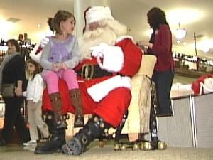 Santa visited with kids at the Roshek Building Friday night