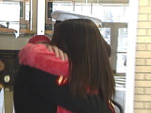 Lance Cpl. Alex Ahmann and his sister Emily Ahmann share an emotional hug Monday
