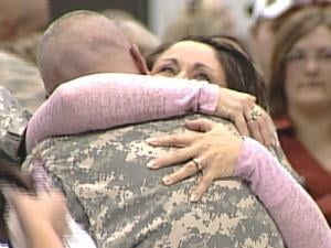 A soldier embraces a loved one at the Wednesday morning homecoming ceremony