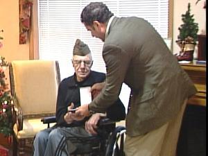 Rep. Bruce Braley (D-Iowa) presents Zane Thorpe with the Purple Heart