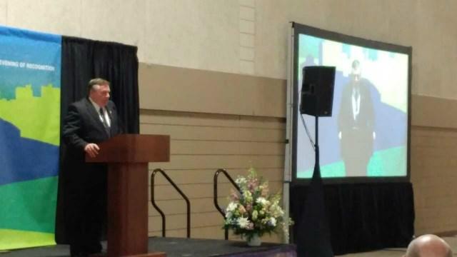 KWWL General Manager Jim McKernan accepts the John Deere Treating Capital Well Award on Tuesday night in Waterloo.