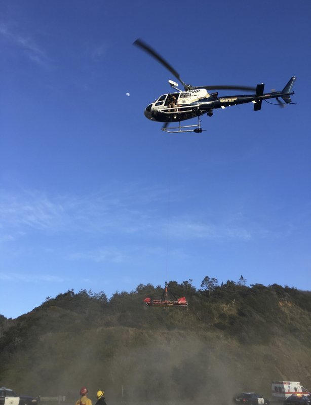 California Highway Patrol via AP). This Tuesday, March 27, 2018, photo provided by the California Highway Patrol shows a helicopter hovering over the scene where a vehicle plunged off a cliff in Northern California near Mendocino, Calif. The Californi...