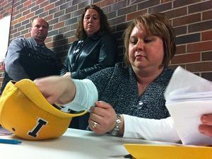 One Dyersville precinct collected ballots, folded, in an Iowa baseball cap