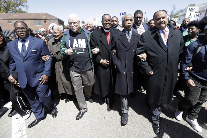 (AP Photo/Mark Humphrey). Martin Luther King III, right, and Rev. Al Sharpton, second from right, join in a march commemorating the anniversary of the assassination of Rev. Martin Luther King Jr. Wednesday, April 4, 2018.