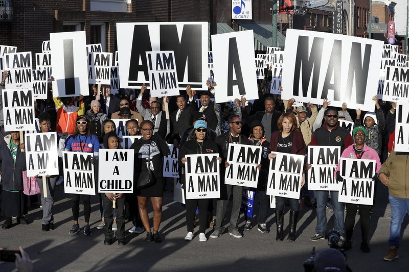 (AP Photo/Mark Humphrey). People hold signs resembling the placards carried by striking sanitation workers in 1968 as they join in events commemorating the 50th anniversary of the assassination of the Rev. Martin Luther King Jr. on Wednesday, April 4...