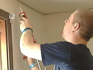 Michael Mulloy helps weatherize a Dubuque home