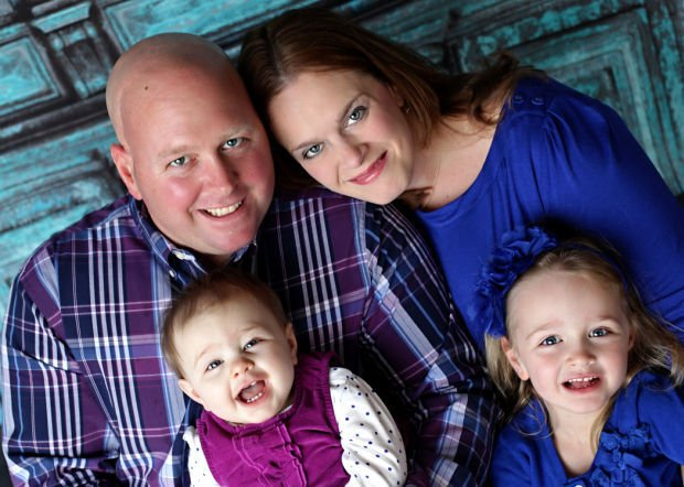 Chris Toneff, with his wife and daughters