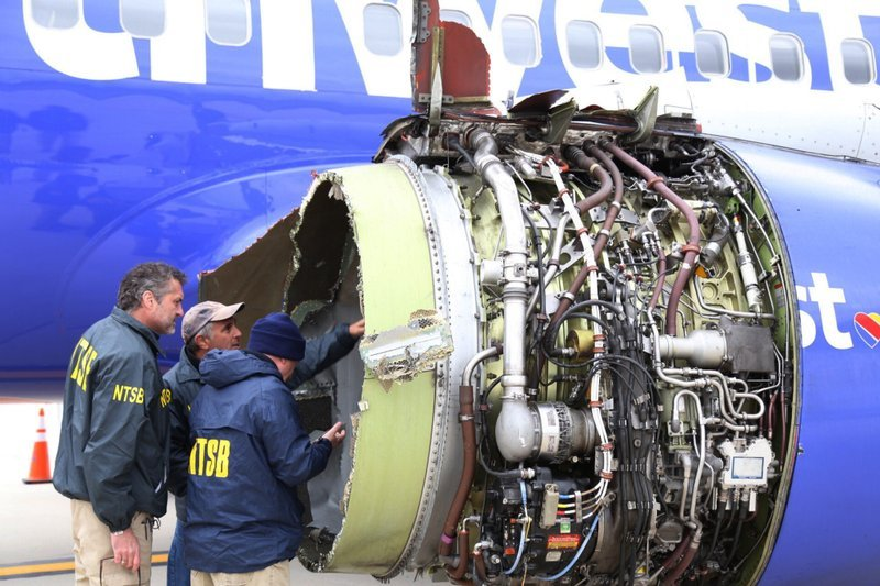 (NTSB via AP). National Transportation Safety Board investigators examine damage to the engine of the Southwest Airlines plane that made an emergency landing at Philadelphia International Airport in Philadelphia on Tuesday, April 17, 2018.