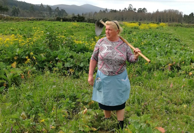 (Paula Vazquez via AP). Dolores Leis stands in a field on her farm in Galicia, in northern Spain, Thursday April 19, 2018. Leis, has found unexpected fame on social media after many found she bore a striking resemblance to U.S. President Donald Trump.