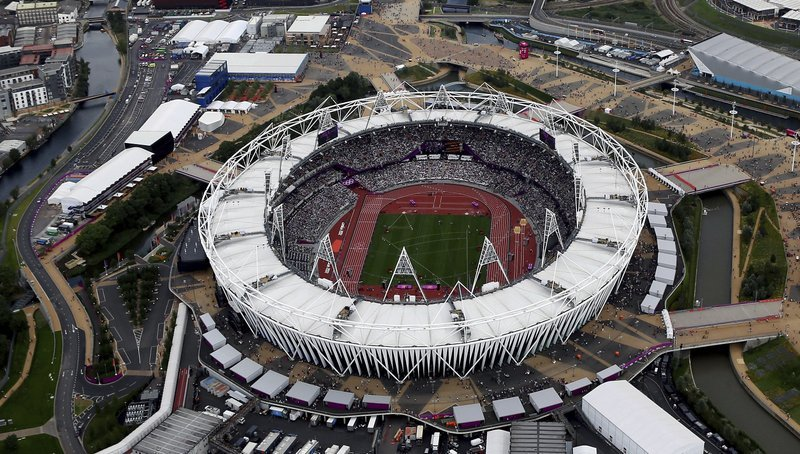 (AP Photo/Jeff J Mitchell, File). FILE - This Aug. 3, 2012, aerial file photo shows the Olympic Stadium at Olympic Park, in London. A person familiar with the planning tells The Associated Press that Major League Baseball intends to announce next week ...