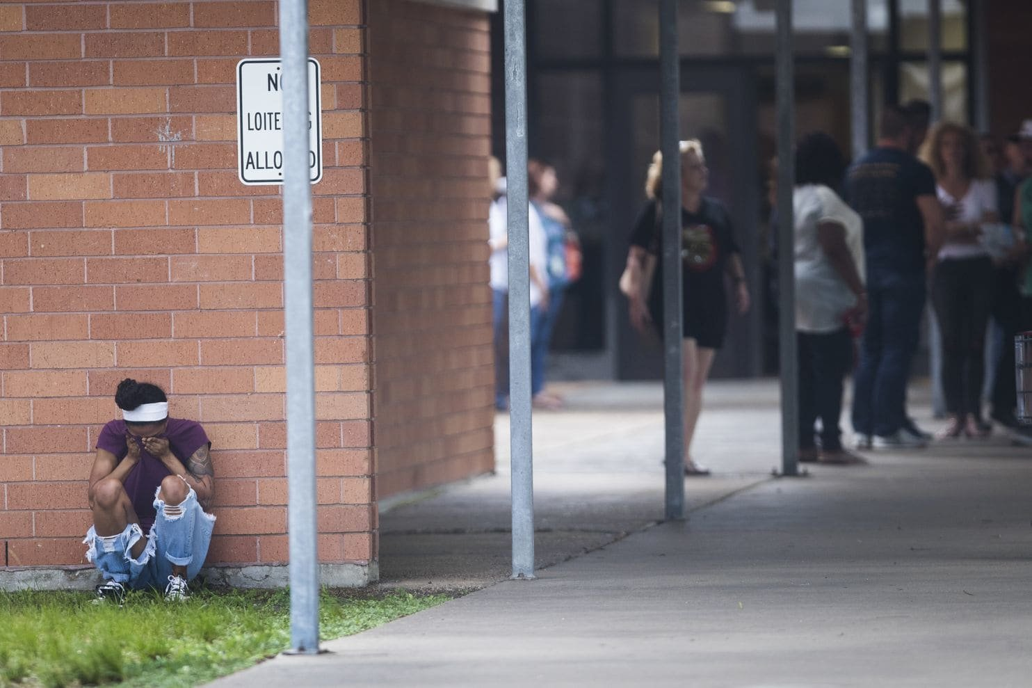 People gather by the Barnett Intermediate School where parents are gathering to pick up their children following a shooting at Santa Fe High School Friday, May 18, 2018, in Santa Fe, Texas. (Marie D. De Jesus/Houston Chronicle via AP) (Associated Press)