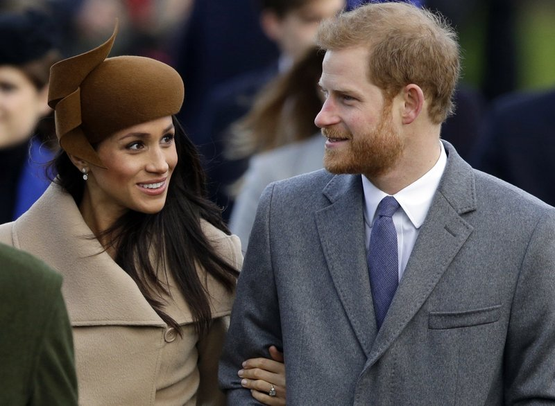 (AP Photo/Alastair Grant, File). FILE - In this Monday, Dec. 25, 2017 file photo, Britain's Prince Harry and his fiancee Meghan Markle arrive to attend the traditional Christmas Day service, at St. Mary Magdalene Church in Sandringham, England. Royal w...