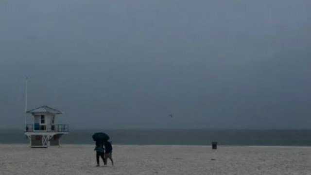 (Jim Damaske/Tampa Bay Times via AP). Rain falls on Clearwater Beach by Pier 60 early Sunday morning May 27, 2018, as northbound Subtropical Storm Alberto looms in the gulf to the southwest. as northbound Subtropical Storm Alberto looms in the gulf to ...