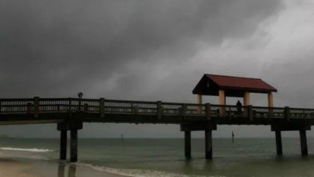 (Jim Damaske/Tampa Bay Times via AP). Rain falls on Clearwater Beach by Pier 60 early Sunday morning May 27, 2018, as northbound Subtropical Storm Alberto looms in the gulf to the southwest.