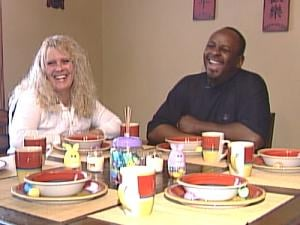 Robert and Nellie Kimble share a laugh at their kitchen table Sunday morning before church