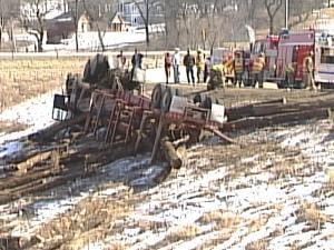 A truck carrying logs rolled over Monday afternoon in Dubuque County