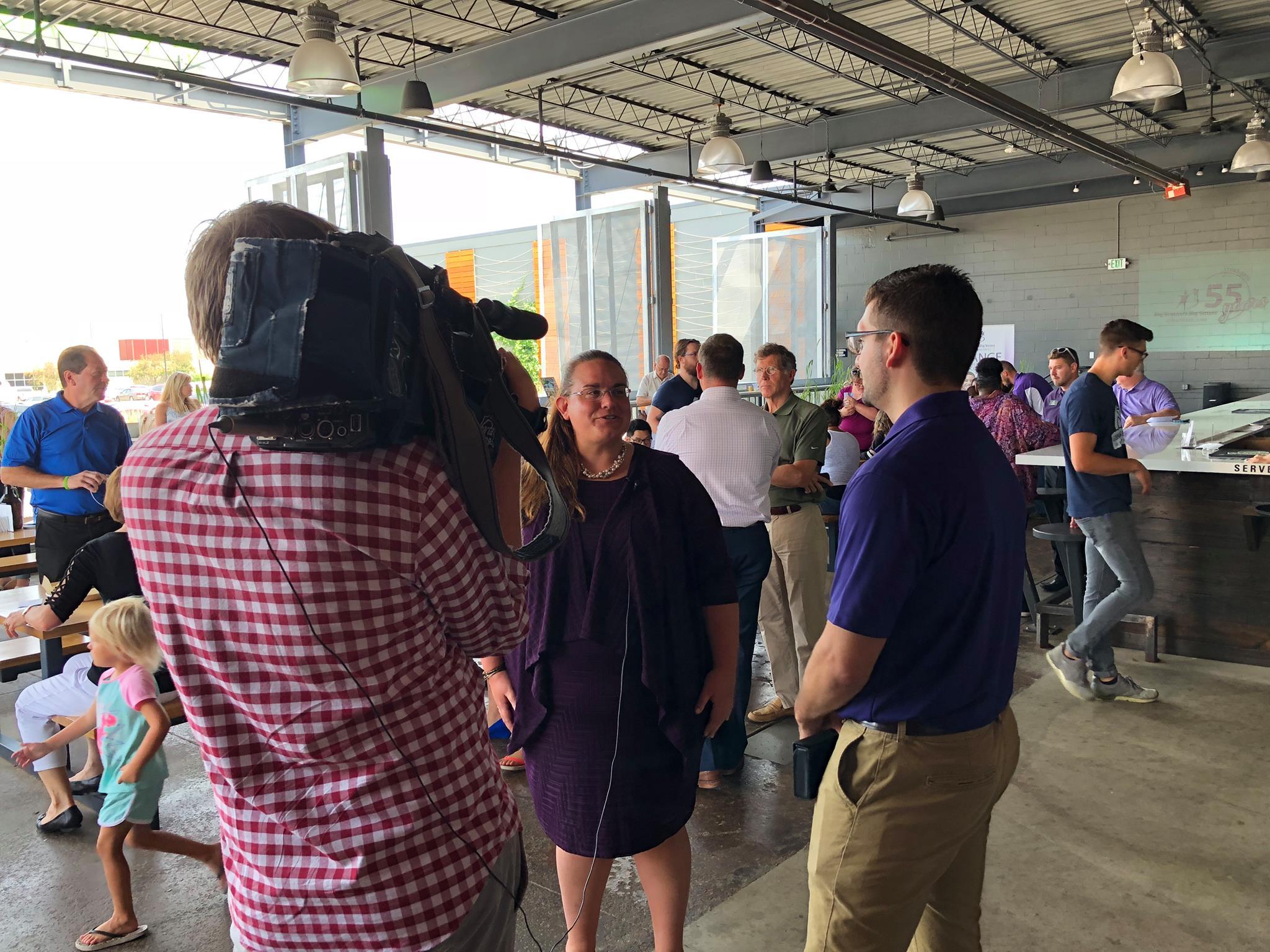 KWWL crew speaking with CEO, Katie Orlando