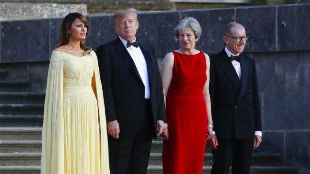 (AP Photo/Pablo Martinez Monsivais) From left, first lady Melania Trump, President Donald Trump, British Prime Minister Theresa May and her husband Philip May watch the arrival ceremony at Blenheim Palace, Oxfordshire, Thursday, July 12, 2018.