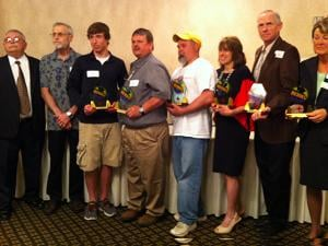 The eight Everyday Heroes award recipients pose for a picture Tuesday morning