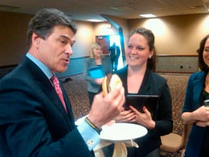 Gov. Rick Perry eats a hamburger with LFTB to show support for the product. Photo courtesy: Twitter @TerryBranstad