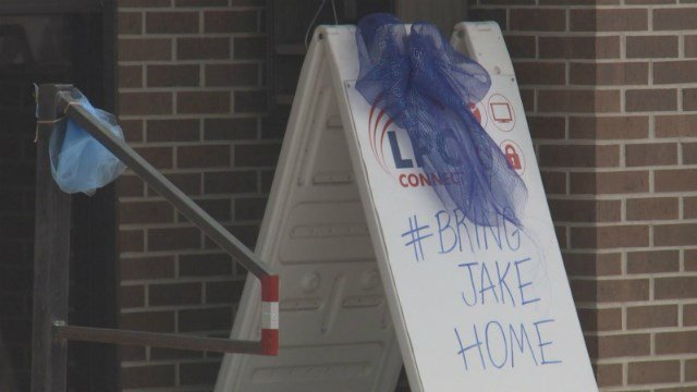 New blue ribbons put up on Tuesday replaced original ones hung in April in support of the effort to bring missing teen Jake Wilson home to La Porte City.