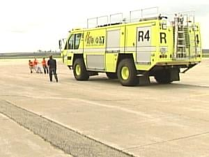 Four participants pull the Dubuque Regional Airport's fire truck. The official competition, however, had teams of eight people.
