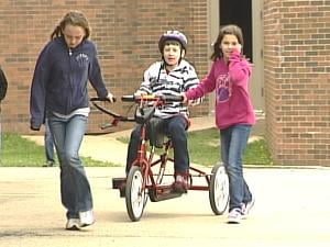 8-year-old Liam McFadden rides an adaptive tricycle at Eisenhower Elementary School Monday afternoon