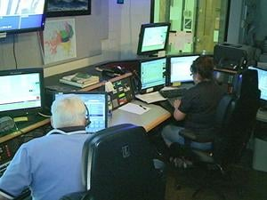 Vicki Leonard, right, works her last day on Friday after 37 years as a Dubuque dispatcher