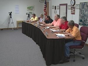 The Dyersville city council members open the special meeting Monday evening