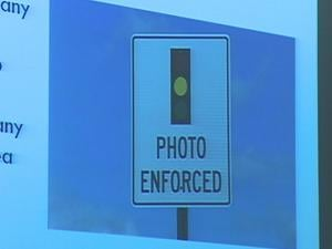The city said intersections with automated traffic enforcement would be clearly marked with signs