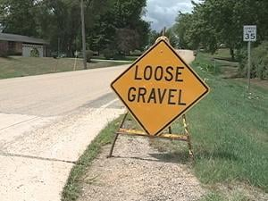 A sign warns drivers of loose gravel on Humke Road in Dubuque County