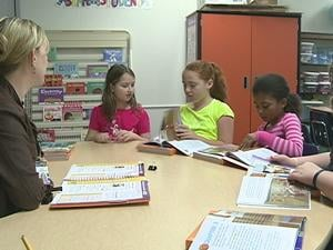 Third grade teacher Michelle Vandermillen works with her students on reading at Dubuque's Audubon Elementary School.