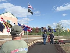 Volunteers finished preparing the site Wednesday in the Port of Dubuque. The wall installation begins Thursday morning.