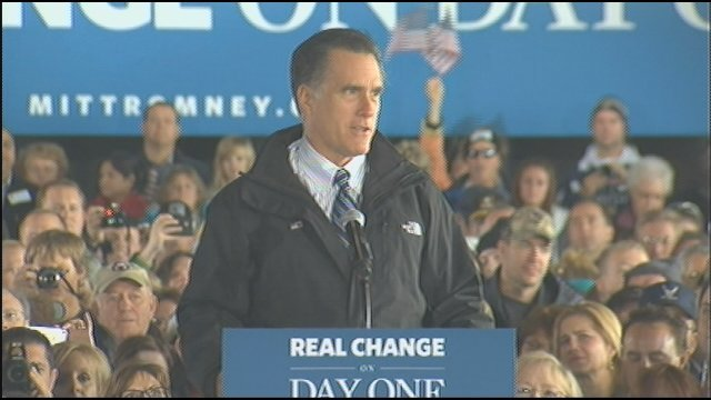 Mitt Romney speaks at the Dubuque Regional Airport Saturday afternoon.