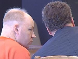 Scott Robinson, pictured at a court appearance in 2011, is charged with convincing another inmate to commit perjury.