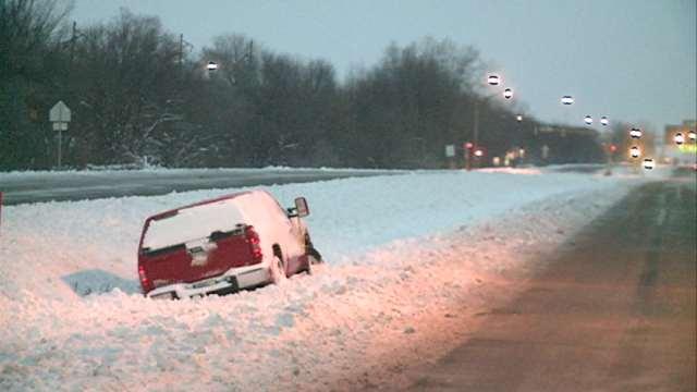 A truck stuck in a ditch off Highway 63 in Cedar Falls.