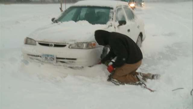 Jesse Burke pulls car off the shoulder of Ridgeway Ave. in Cedar Falls.