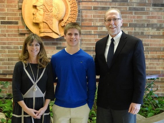 Loebsack, right, poses with Jackson Peplow and his mother, Nanci Kohl, at West High.