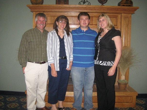Rick Schneider and his wife, Tammy, and Adam Schneider and his wife, Nikki.