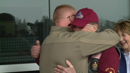 Lt. Commander Kelsey Foster hugs his father, Larry Foster