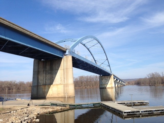 Authorities say an approximately 10 foot piece of cosmetic concrete fell from the bridge