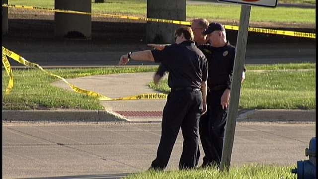 Police at scene of fatal hit and run, April 9, 2012