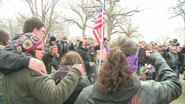 Family members and friends participated in a graveside tribute.