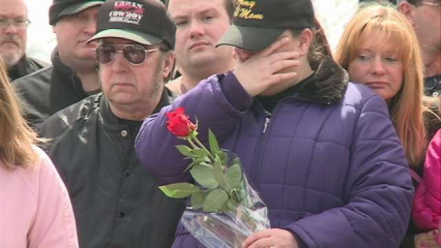 Family members and friends remember the 21-year old Iowa Guardsman at his grave site.