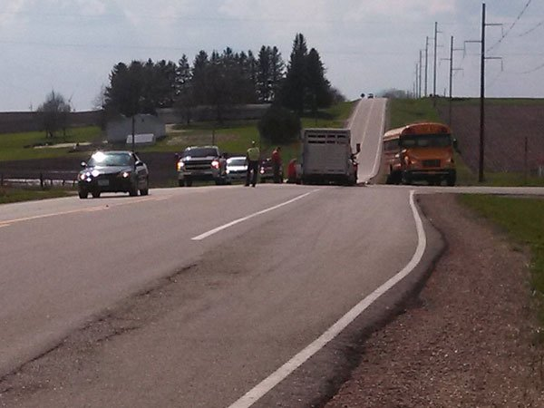 A Gladbrook-Reinbeck school bus and a truck hauling livestock collided Monday afternoon in rural Tama County.